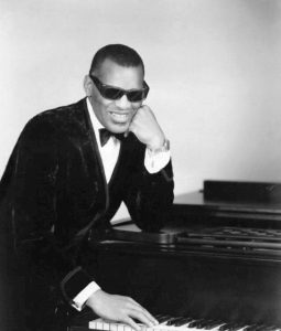 Ray Charles striking a classic piano pose.