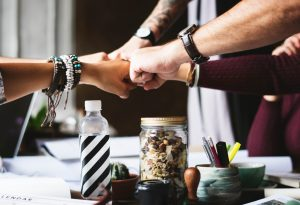 Fist-bumps - you should do your best to keep your team whole when planning a corporate relocation.