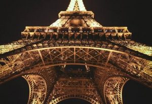 Eiffel tower at night with lights on.