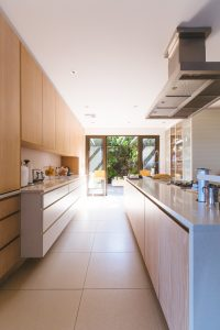 Image of a kitchen with glass doors to the garden