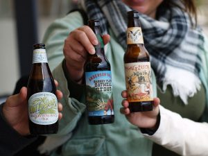 People toasting with some of the many craft beers that you can find in Colorado.
