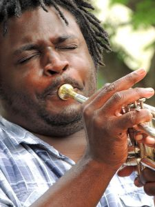 Jazz musician playing the trumpet.
