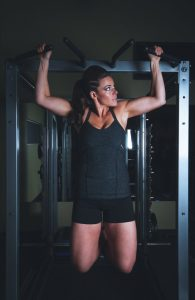 A girl training on a machine