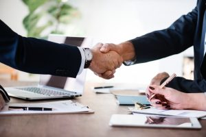 Handshake - making a good deal is the best way to cut moving costs.