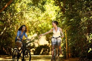Girls riding a bike in Nampa parks