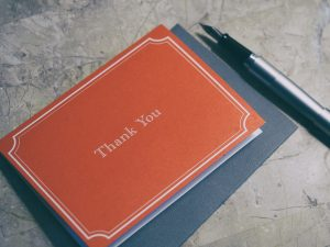A red thank you note