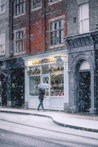 A man waking in heavy snow