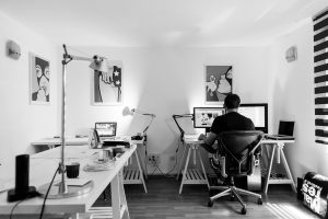 Black & white image of a guy in his home office