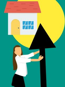 A good agent increasing the value of property, like this realtor holding an upward arrow.