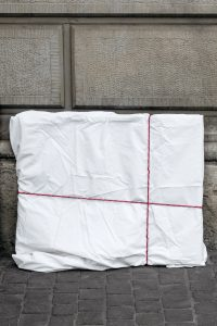 A painting wrapped in a white sheet