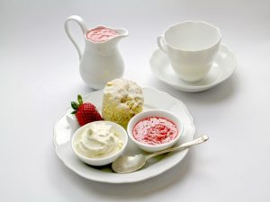 A white dessert set with cakes and spreads, as an example of items movers won't move.