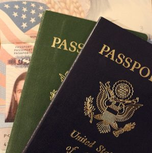 Two passports that will help you register your out of state car in Texas.