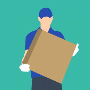 A man carrying a box.