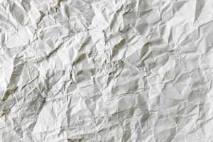 A crumpled wet paper you shouldn't bring when you want to recycle packing materials in Portland, Oregon