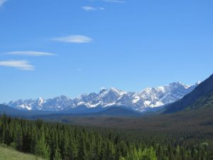 The slopes of the Rocky Mountains seen from a distance.
