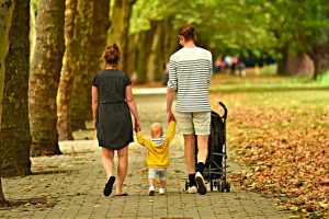 Family walking in a park.
