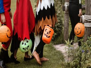 Kids in costumes trick-or-treating, instead of going to one of the top places to celebrate Halloween across the US.