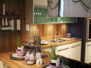 Cutlery and bowls on kitchen countertops, before you organize the kitchen after you move.