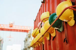 Helmets placed along the side of a shipping container