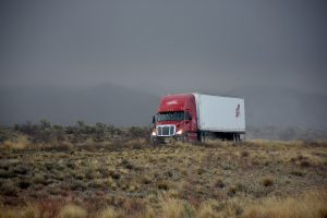 Truck on a foggy road - sometimes transit insurance for moving interstate is a must.