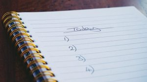A checklist in a notebook - top among moving tips for people with disabilities.