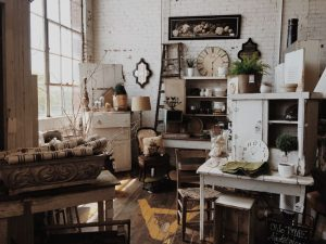 A room cluttered with a lot of wooden furniture and items.
