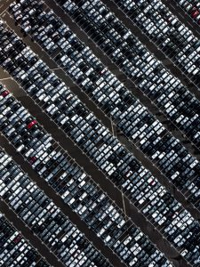 Large parking lot filled with cars
