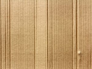 A cardboard texture, as one of the reasons to use plastic bins when moving home.