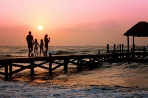 a family on a pier during the sunset