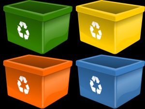 Four plastic bins with recycling signs, in different colors.