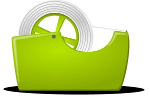 A green holster for packing tape, with some inside.