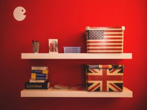 Shelves with items in a red, pristine storage unit.