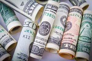 Dollar bills to pay for cross country moving companies Texas.