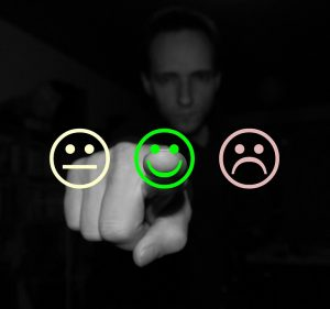 A man pointing to a smiley face.