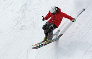 A man skiing down a slope.