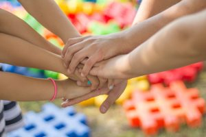 A group of kids holding hands.
