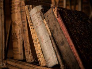 A shelf with antique books.