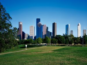 A view of downtown Houston from a park.