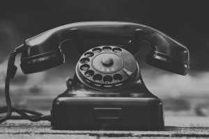 A black phone for calling long distance moving companies Lakewood.