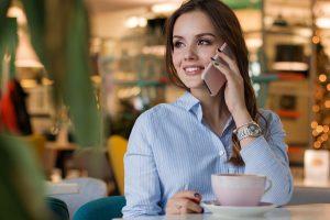 A girl contacting cross country moving companies North Carolina.
