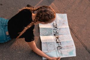 Long distance moving companies Naperville - girl holding a map