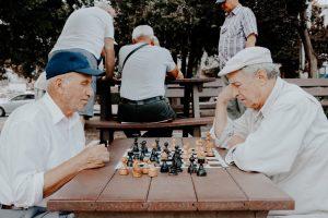 elderly playing chess