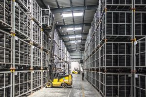 Long distance moving companies Aurora - forklift in the storage