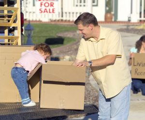 man and a child with a moving box