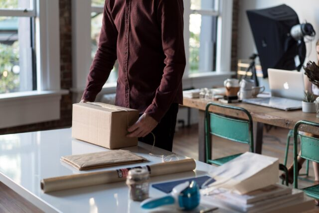 Man packing a box.