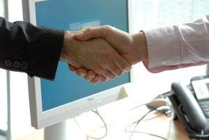 friendly handshake for your Raleigh move
