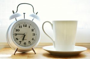clock and cup of coffee in Tulsa