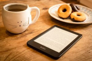 Tablet, coffe mug, donuts