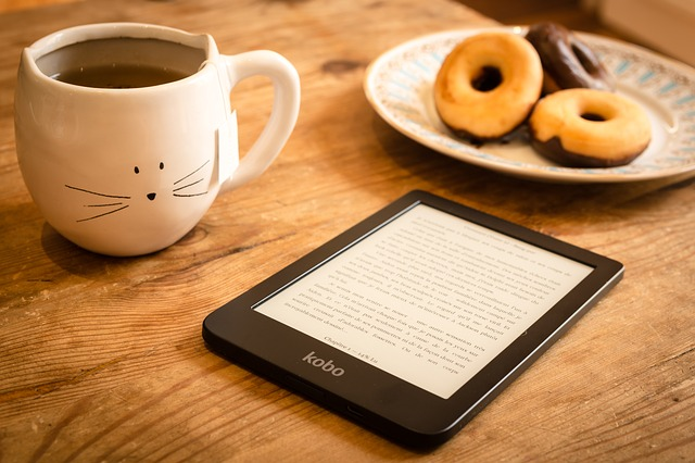 Tablet, coffe mug, donuts