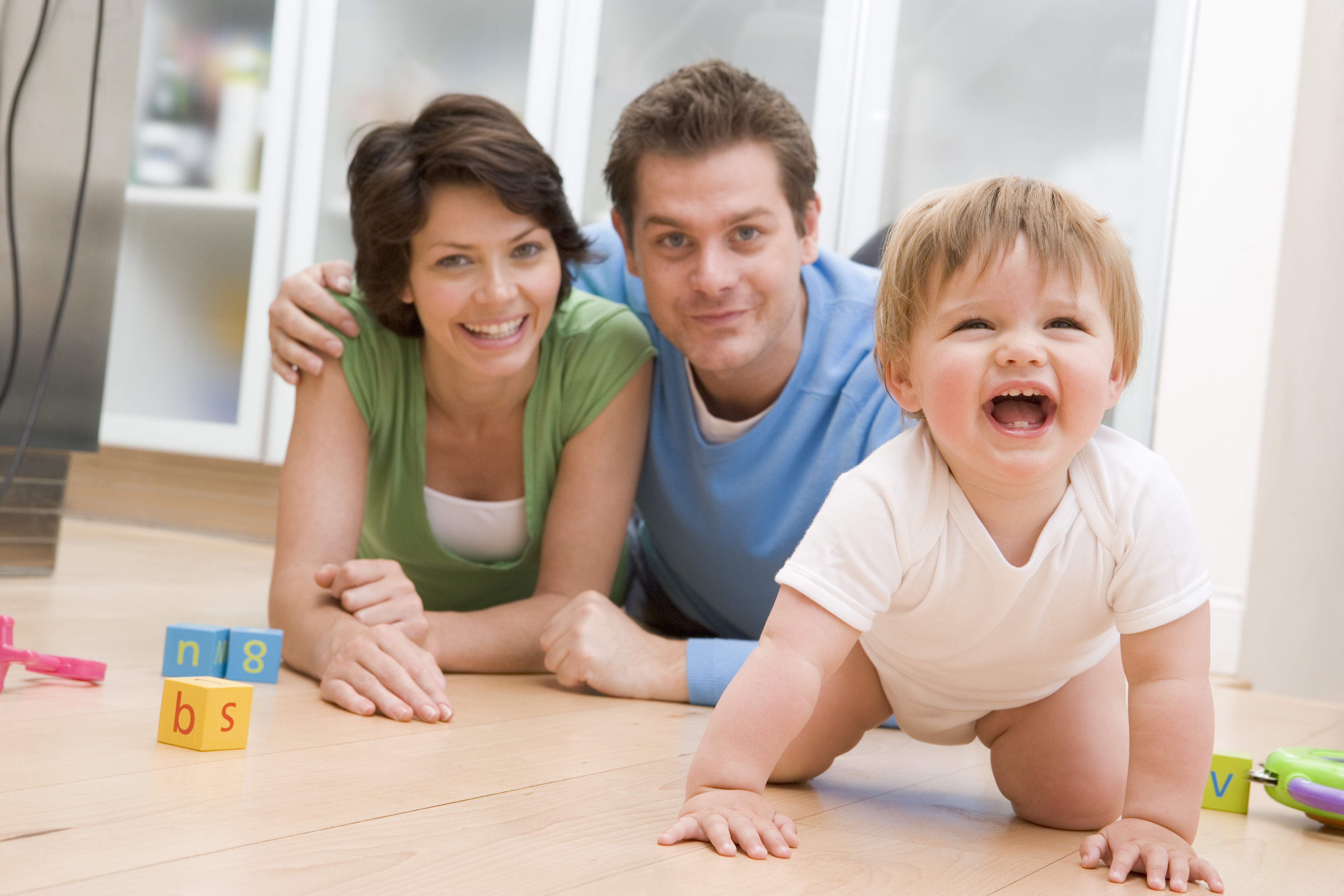 Crawling baby with parents - long distance moving companies Gillette
